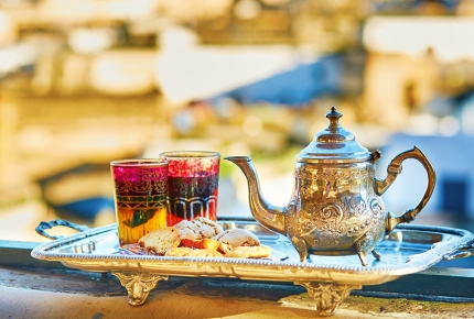 Enjoy a cup of Moroccan mint tea and sweets in Marrakech.