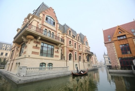 Enjoy a peaceful gondola ride down the Dalian canal.