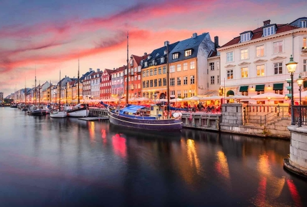 Nyhavn is the picture-perfect 7th-century waterfront in Copenhagen, Denmark