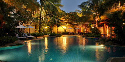Romantically lit pool at Settha Palace Hotel