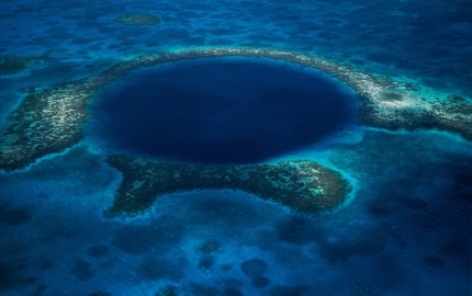 The Great Blue Hole is a feature of the Belize Barrier Reef