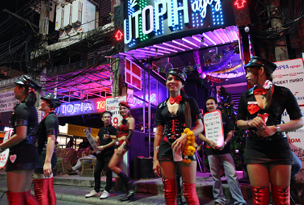 Women trying to entice customers into Utopia in Patpong, Bangkok