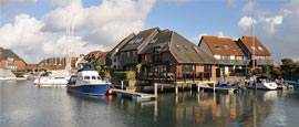 Southampton's waterside houses are best observed from a boat tour.