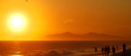A paraglider enjoys the sunset in Rio de Janeiro