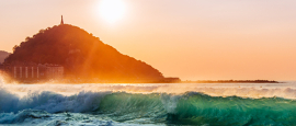 The sun sets over the beach at San Sebastián in Spain