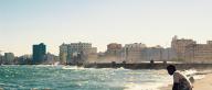 Waves crash against Havana's Malecón coastal road
