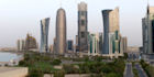 The bustling city of Doha nestled against the Persian Gulf
