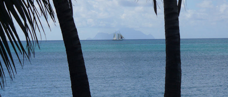 Saba island with yacht in foreground